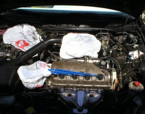 covering engine before cleaning